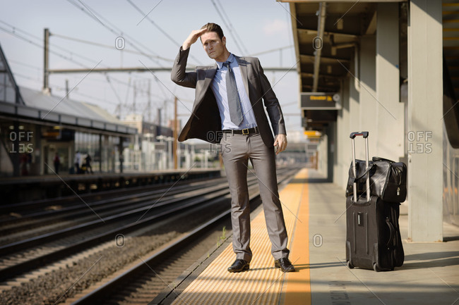 Man checking for train