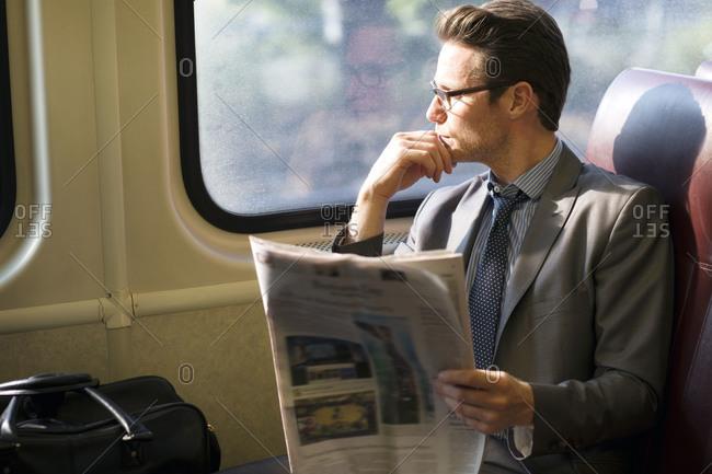 Man riding commuter rail