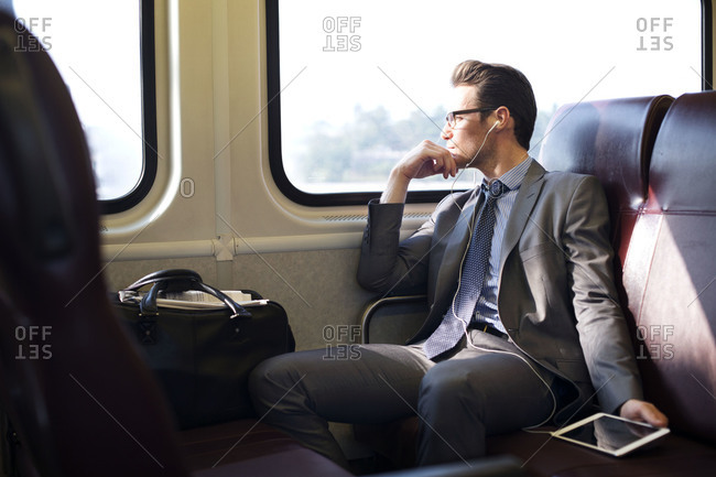 Man looking out window on train