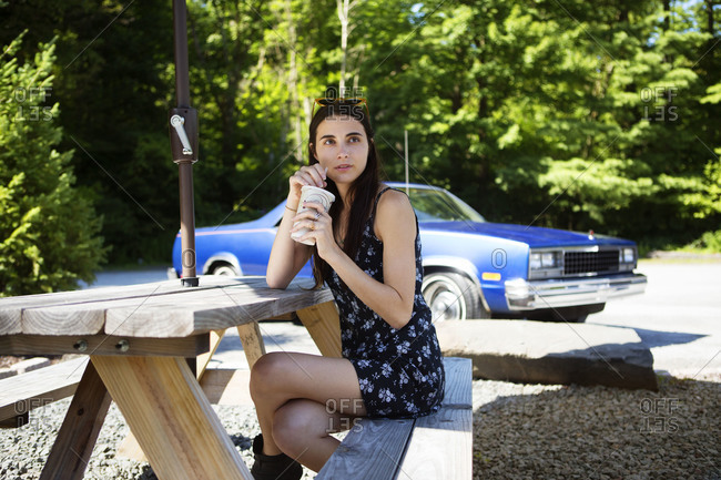 Woman at picnic table in rest stop