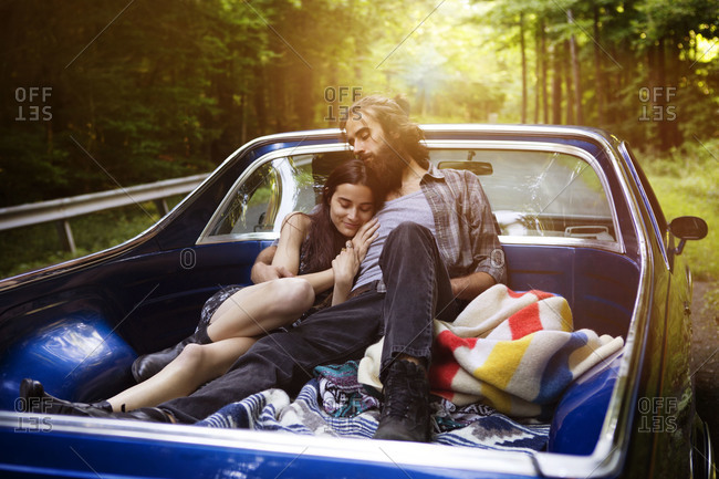 Couple lying down in truck bed