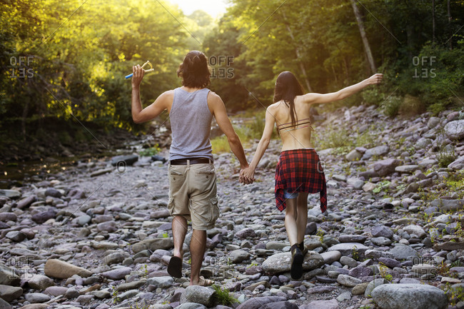 Couple walking by river
