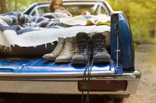Couple sleeping in back of truck