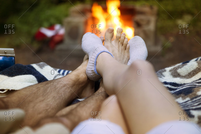 Couple's feet by fire