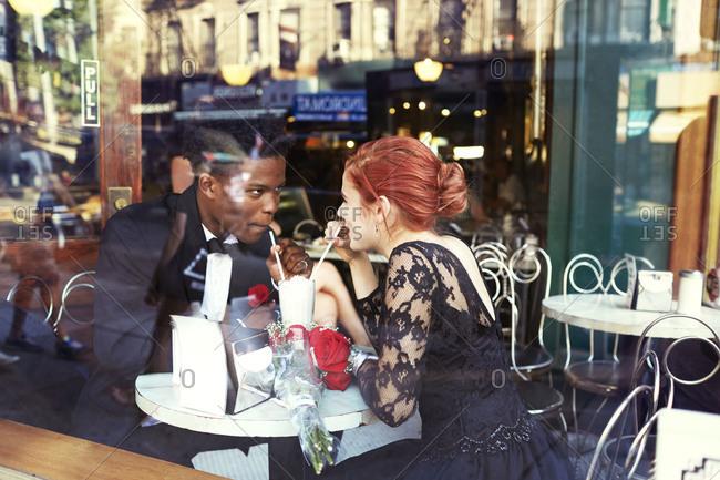 A couple having milkshake