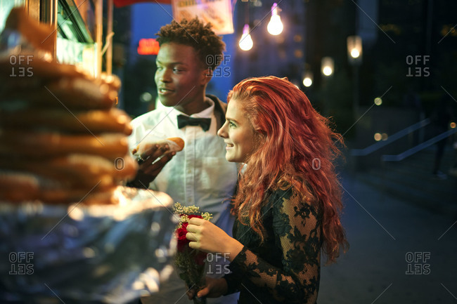 Couple ordering at food truck