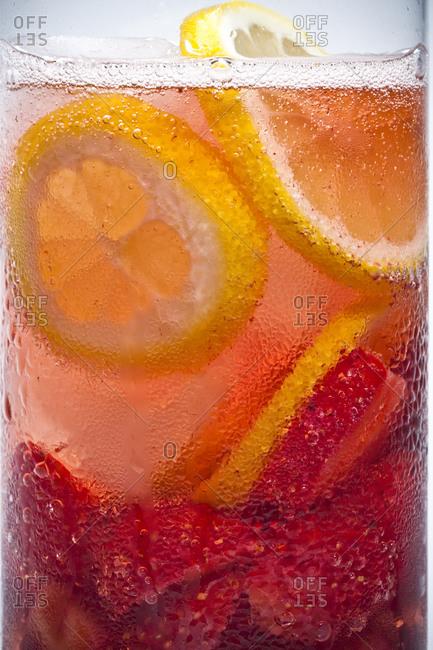 Lemon slices float in a cold drink