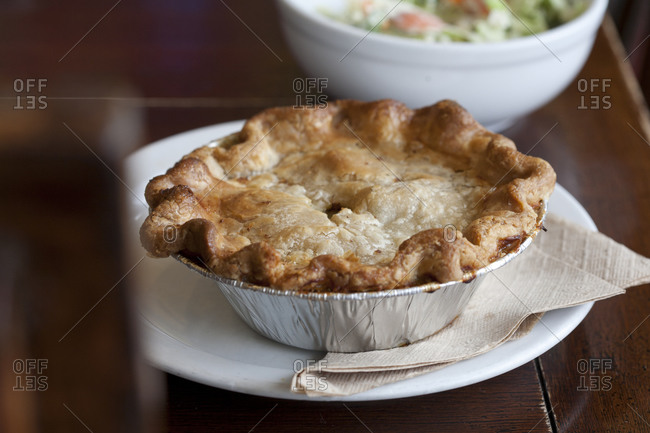 A chicken pot pie cools in a pan