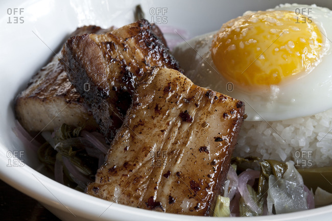 Pork belly and other Asian ingredients sit in a bowl