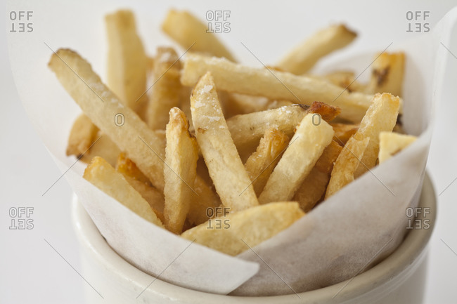 A side of french fries stands in a cup