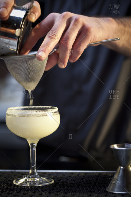 A man mixes a margarita