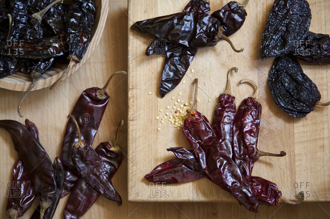 Dried peppers lay on cutting boards