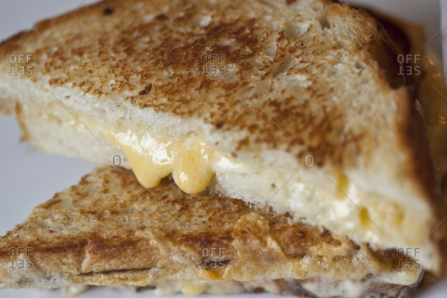 Cheese melts out of a grilled cheese sandwich
