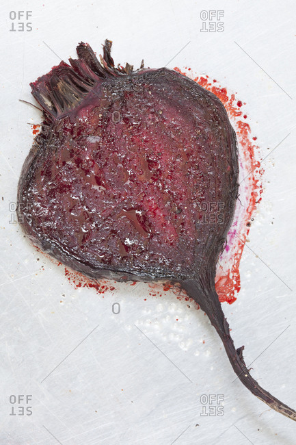 A halved beet lies on a table