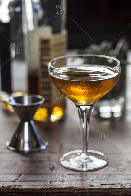 A cocktail sits on a bar
