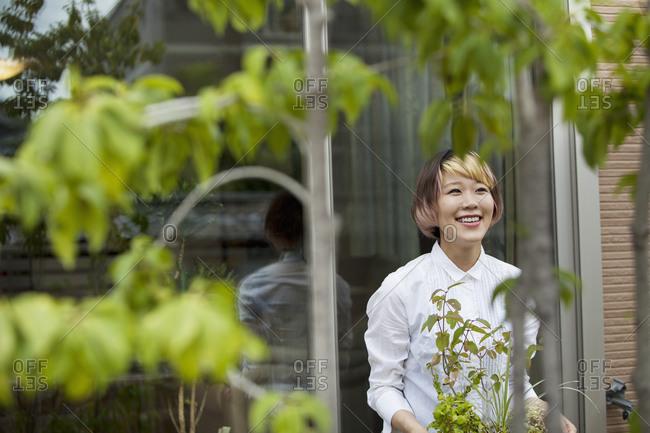A woman standing in her garden