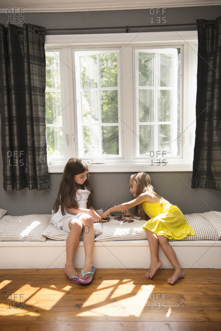 Two girls playing together indoors