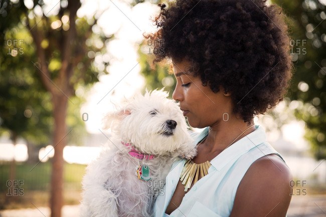 Young woman out with her dog in Brooklyn, New York