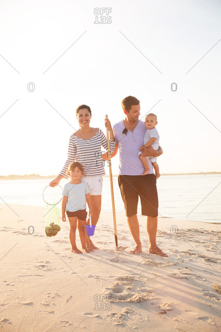 Family collecting shells together