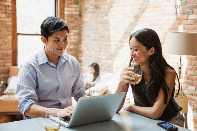 Woman speaking while her husband using laptop