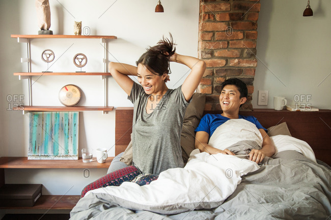 Young couple smiling in the bed