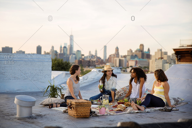 Friends having a picnic on a rooftop in Brooklyn