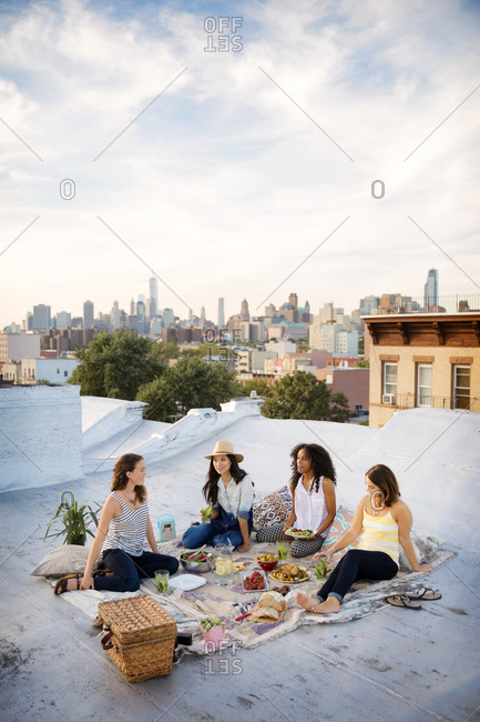 Friends having a picnic on a rooftop