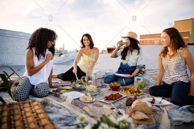 Friends having dinner on a rooftop in Brooklyn