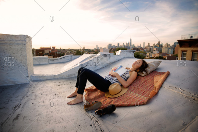 Woman napping on a rooftop in Brooklyn