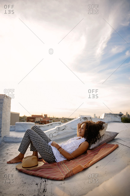 Young woman resting on a rooftop in Brooklyn