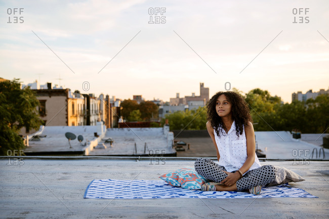 Young woman relaxing on a rooftop in Brooklyn