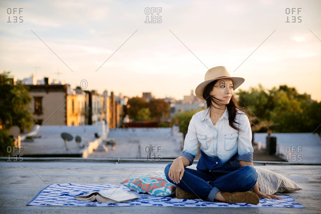 Woman sitting on a rooftop in Brooklyn