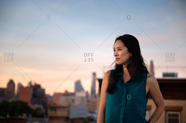 Portrait of woman on a rooftop at sunset