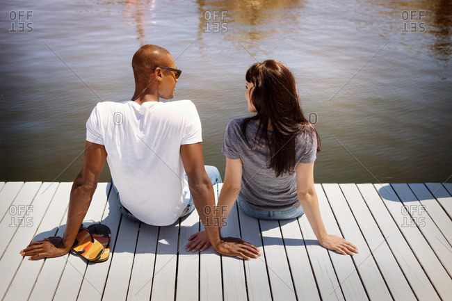Young couple sitting on dock