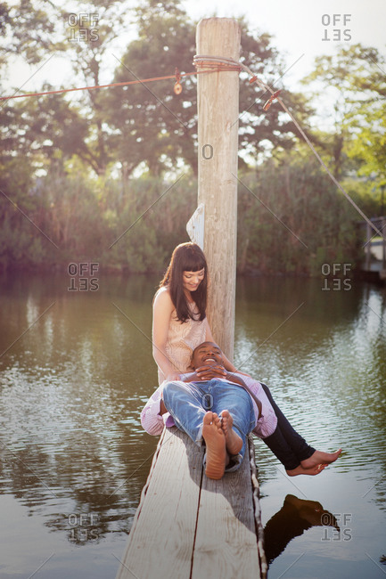 Couple relaxing together on a wooden dock