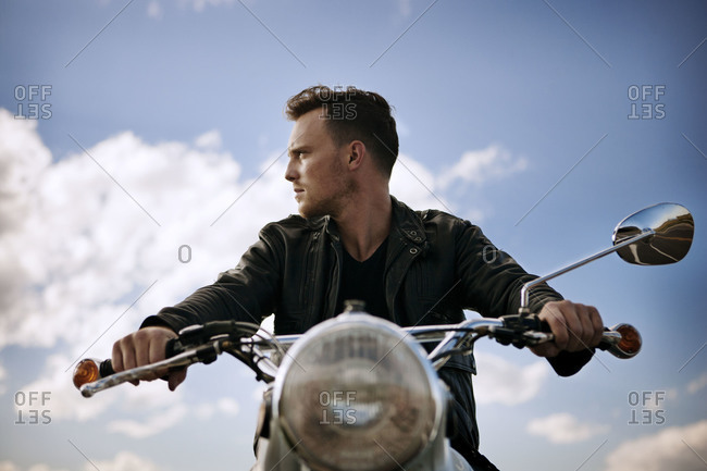 Man in leather jacket on motorcycle