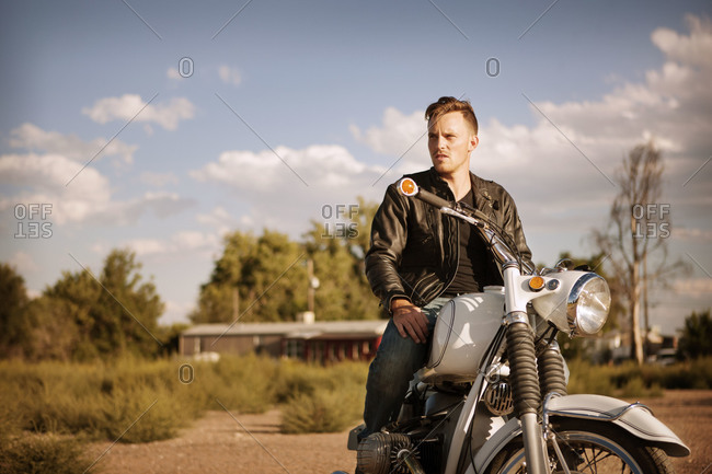 Portrait of a man sitting on his motorcycle