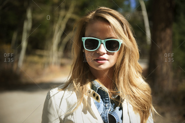 Young woman wearing blue sunglasses