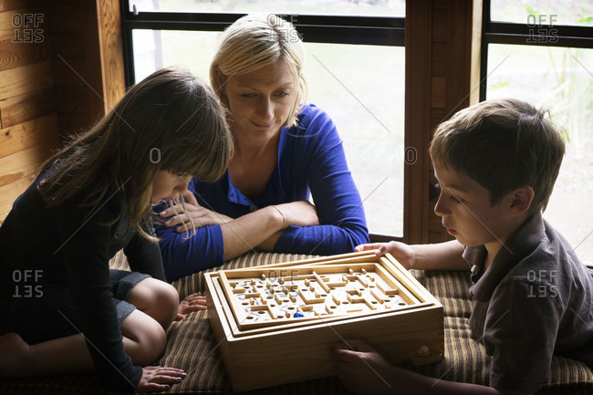 Mother and children playing a game