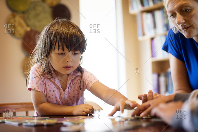 Mother and children playing game