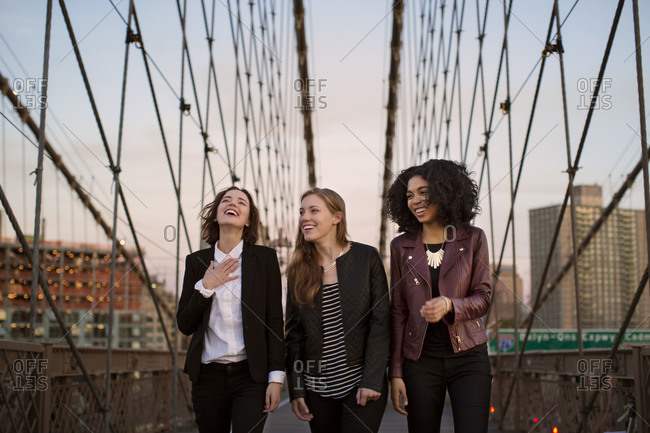 Sophisticated young women hanging out on the Brooklyn Bridge, New York