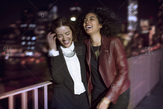 Young women hanging out on the Brooklyn Bridge