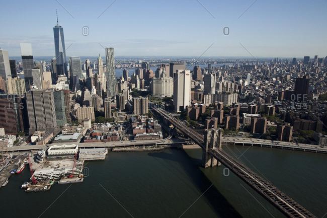 New York, NY, USA - September 17, 2014: One World Trade Center and the Brooklyn Bridge in New York City