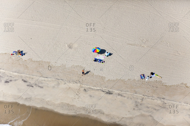 Aerial view of people resting on beach