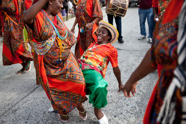 City of Quibdo, Choco Region, Colombia - September 21, 2012: A man and a woman in costume dance at Quibdo's carnival