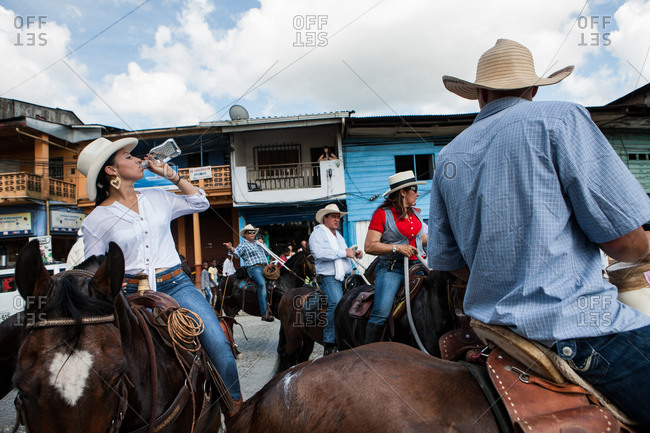 City of Quibdo, Choco Region, Colombia - September 22, 2012: A woman on a horse drinks rum celebrating Carnival in Quibdo.