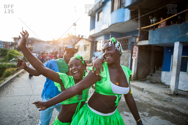 City of Quibdo, Choco Region, Colombia - September 26, 2012: Two women and a man celebrating carnival in Quibdo