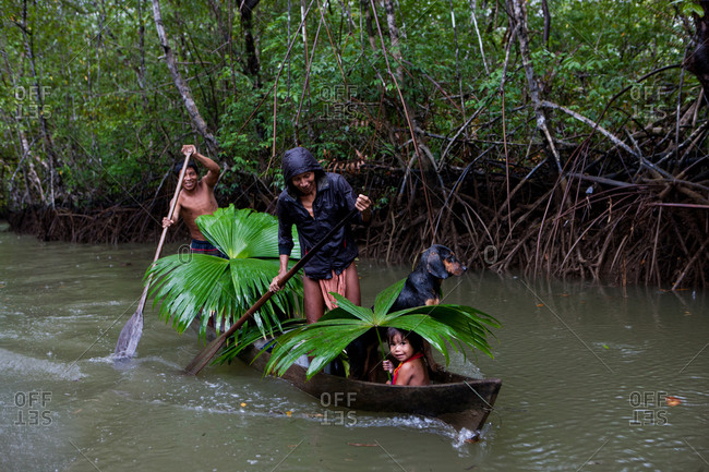 Choco Region, Nuqui, Colombia - October 1, 2012: Indigenous family on a boat in a mangrove in the Colombian Jungle