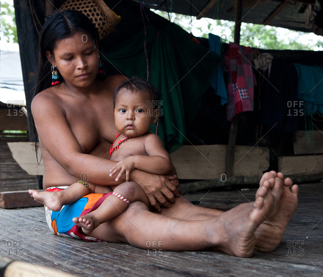 Choco Region, Nuqui, Colombia - September 27, 2012: Mother and Child from an Embera tribe at their home