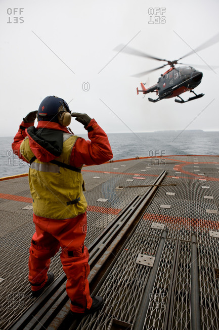 A helicopter landing on the platform of an icebreaker